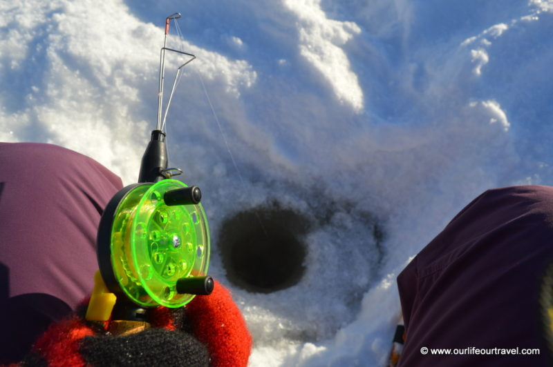 Ice-fishing in Lapland, Finland.