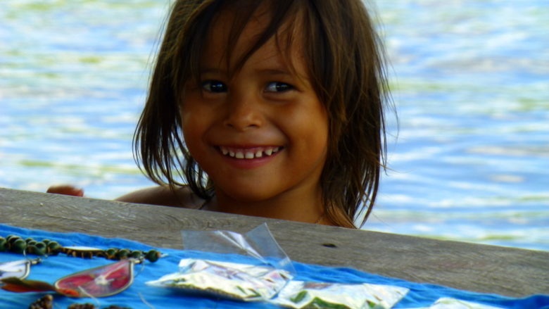 Little local girl selling handmade crafts. Visiting the rainforest near Manaus, Brazil.