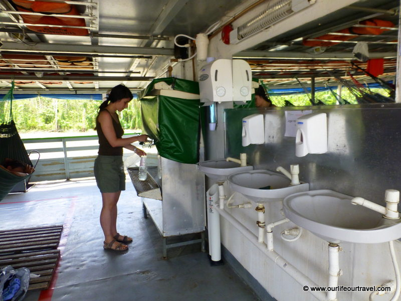 Drinking water on the boat. Tabatinga - Manaus boat ride