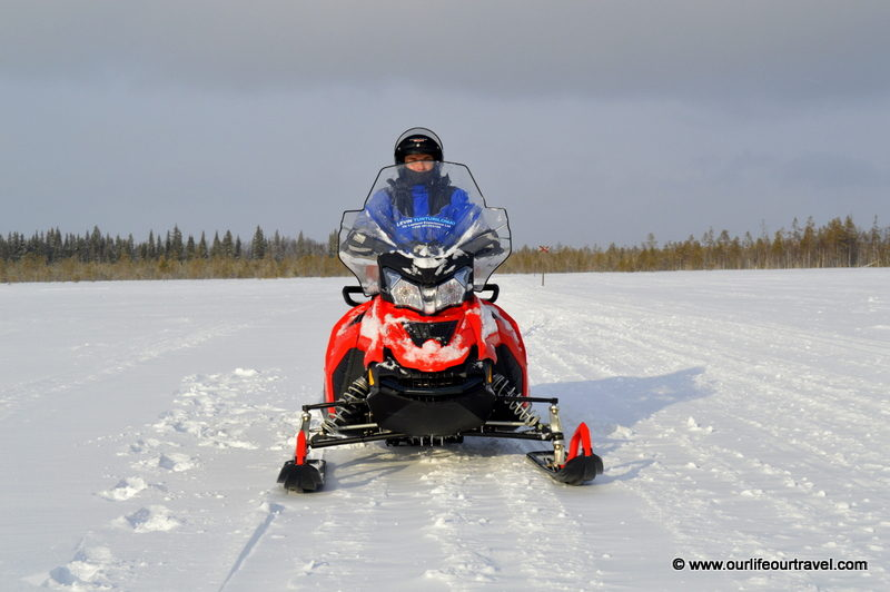 Riding a snowmobile around Levi, Finland
