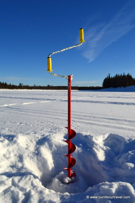 Drill: Ice-fishing in Lapland, Finland.