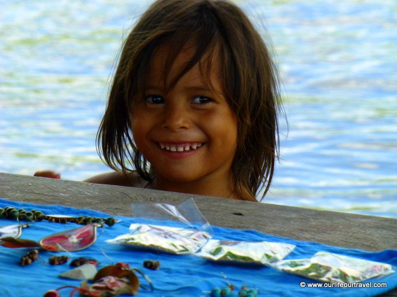 Little local girl selling handmade crafts. Visiting the rainforest near Manaus, Brazil.