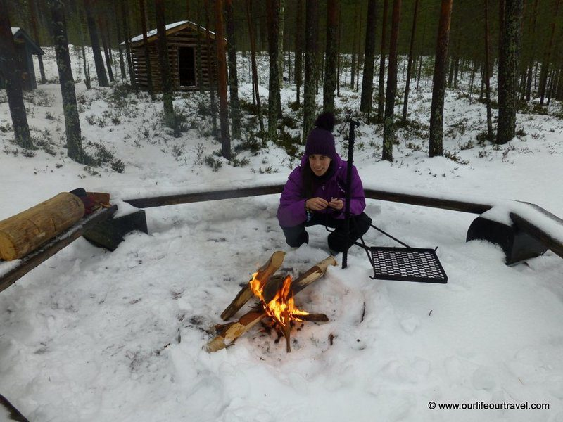 Making fire during the winter in front of a shelter in Finnish National Park