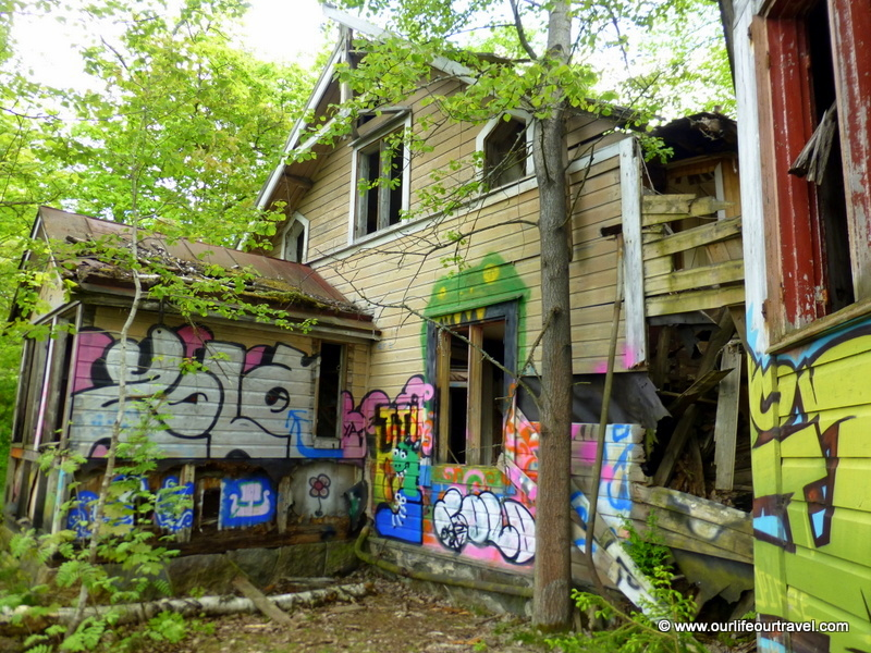 Abandoned villa covered with graffiti.