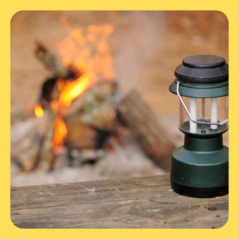 best camping gadgets: lanterns at the campfire