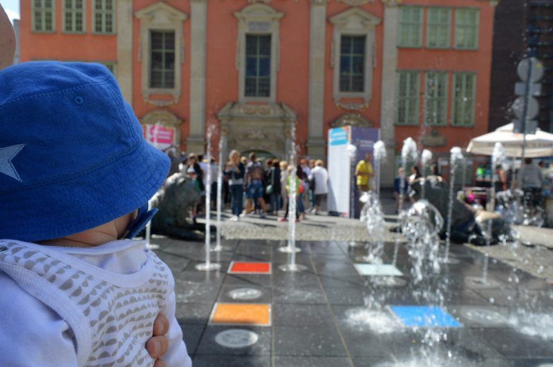 Fountain at Gdansk Old Town with a Baby